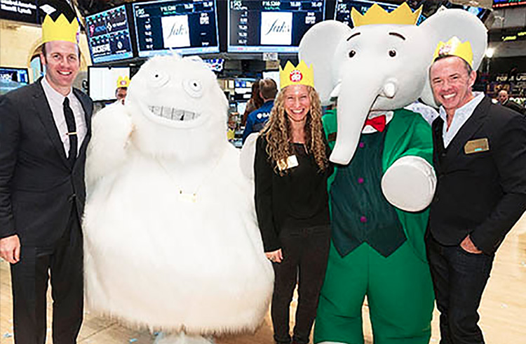 Grand Communications' Alison Grand and Nelvana Enterprises' Colin Bohm (left) and Andrew Kerr don festive crowns to celebrate the 80th birthday of the world's most famous elephant, Babar, along with Saks' legendary Yeti just after ringing the Closing Bell at the New York Stock Exchange