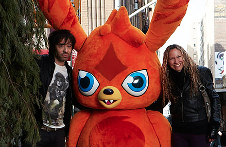 "Alison Grand and Mind Candy CEO Michael Acton Smith (aka ""Mr. Moshi"") get their close-up with Katsuma during the photo shoot for the May 2012 issue of Fast Company magazine"