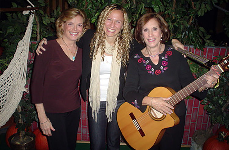 Alison Grand humming along with the stars of The Magic Garden, Carole Demas and Paula Janis, on the set of CW11 Morning News to celebrate the launch of their new DVD from Koch Records