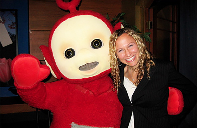Alison Grand and Po of Teletubbies fame smile for the camera behind the scenes at CW11 Morning News