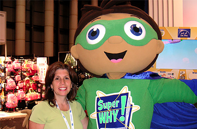 "The literacy-powered star of Super WHY! comes to the ""rescue"" of Grand Communications' Laura Liebeck at International Licensing Show in New York"