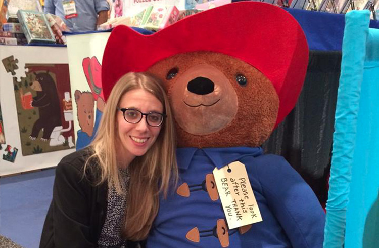 Jaymie Ivler of Grand Communications with YOTTOY's larger-than-life Big Screen Paddington Bear at New York International Toy Fair