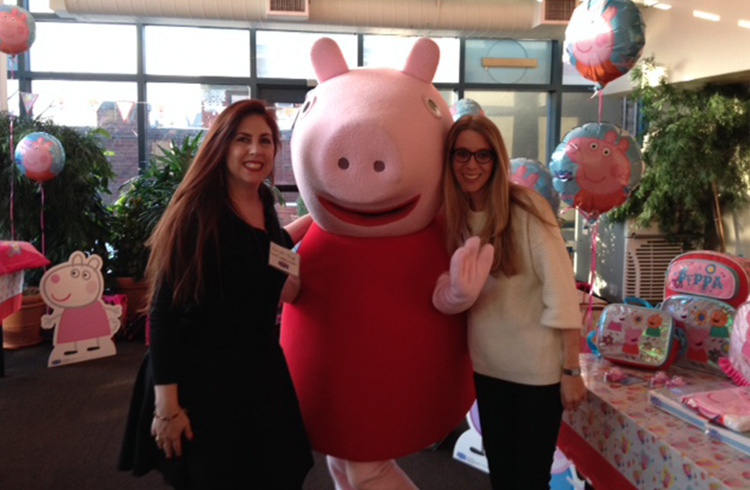 The Grand team's Gabrielle Torello and Jaymie Ivler having more fun then jumping in a muddy puddle with world-famous preschool sensation Peppa Pig at eOne's licensee day in NYC