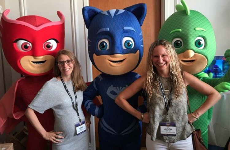 Grand Communications' Jaymie Ivler and Alison Grand having a SUPER time with the PJ Masks at Holiday of Play