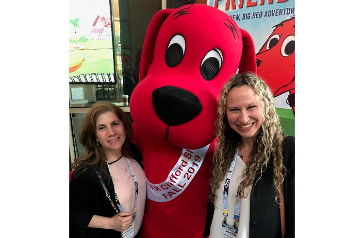 It's puppy love for Grand Communications' Alison Grand and Laura Liebeck at Scholastic Entertainment's cocktail party celebrating the upcoming reboot of Clifford The Big Red Dog at Licensing Expo in Vegas
